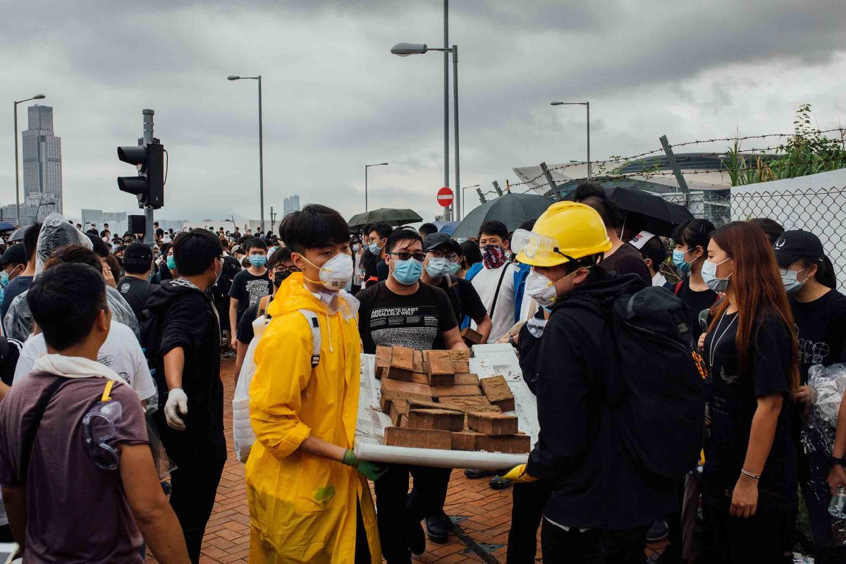 Demonstrators transport bricks at a protest site on June 12. Police said some protesters threw bricks at officers.