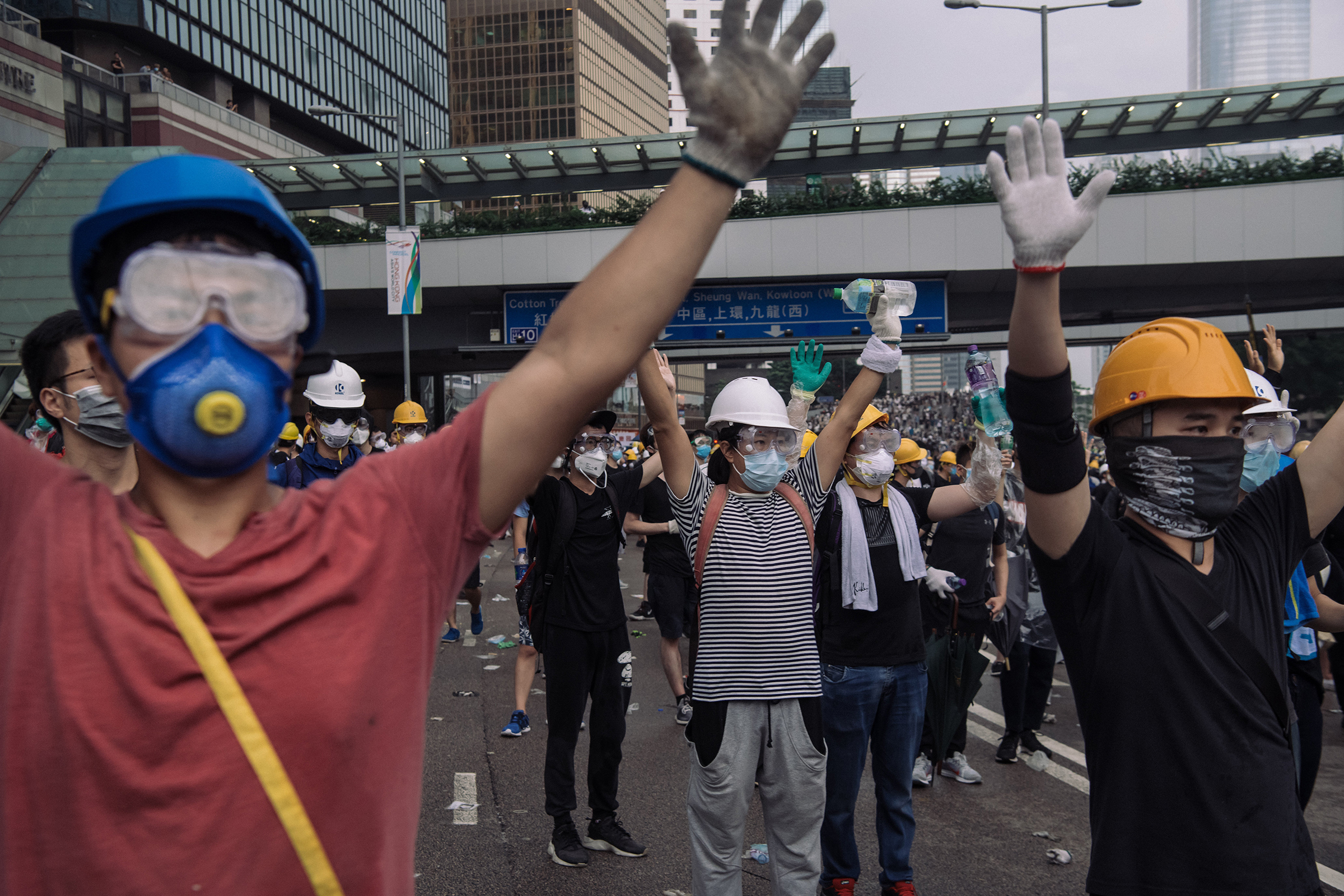 Protesters raise their hands during a protest on June 12.