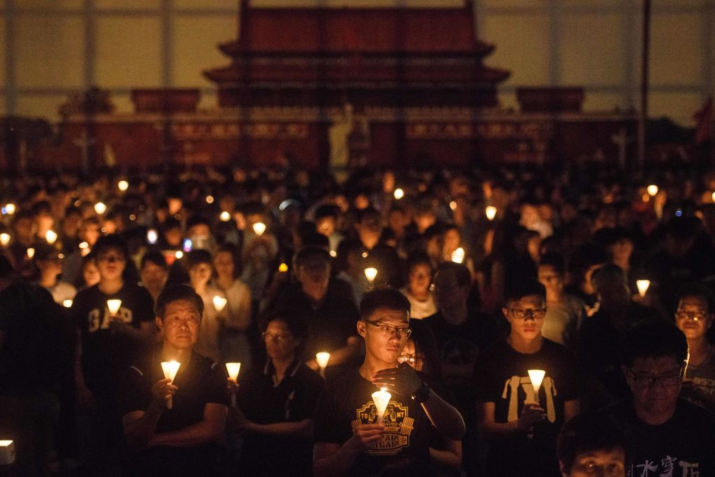 People hold candles during a vigil in Hong Kong on June 4, 2018, to mark the 29th anniversary of the 1989 Tiananmen crackdown in Beijing.