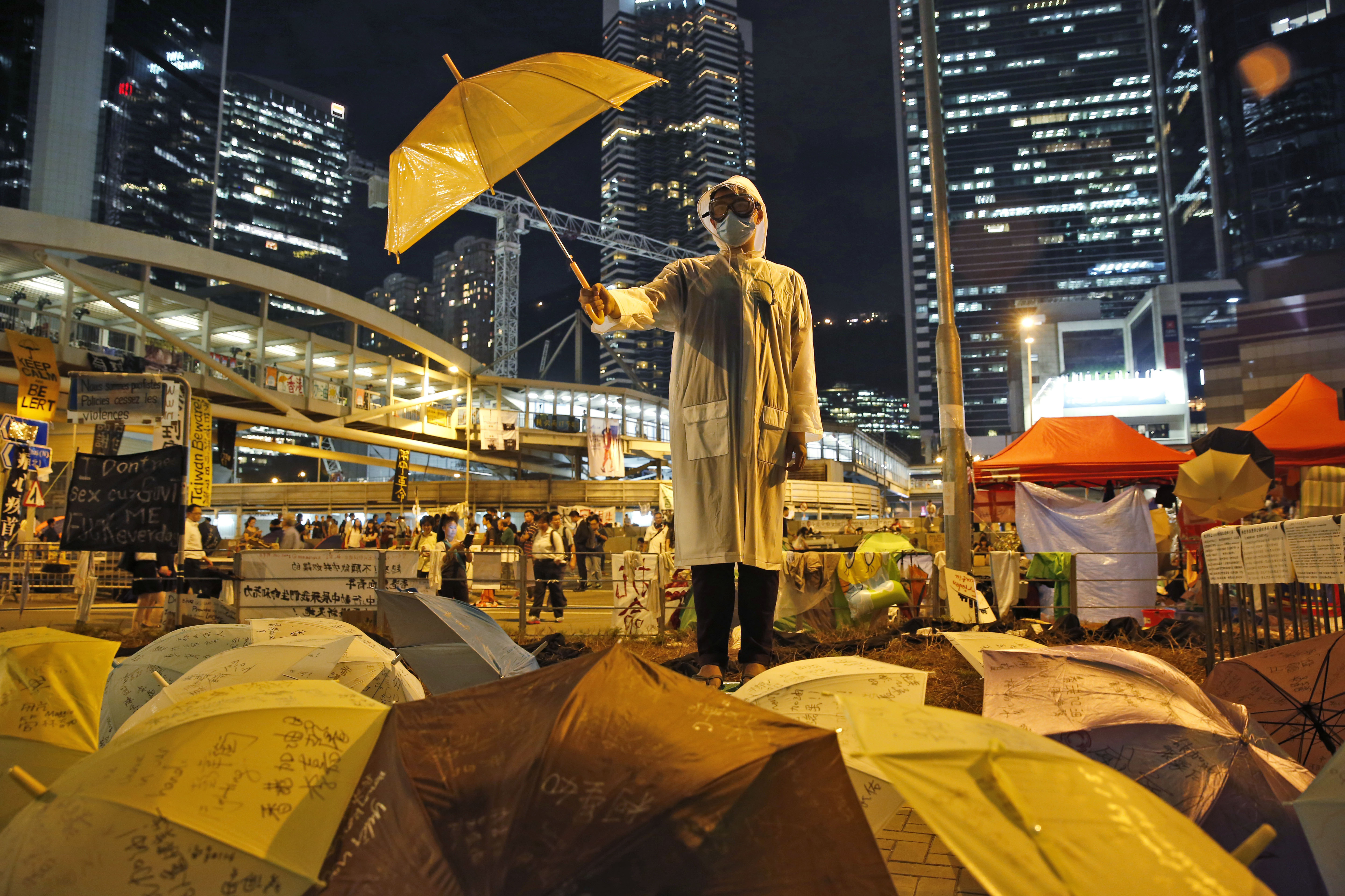 A protester holds an umbrella on a main road in the occupied areas outside government headquarters in Hong Kong's Admiralty on Oct. 9, 2014.