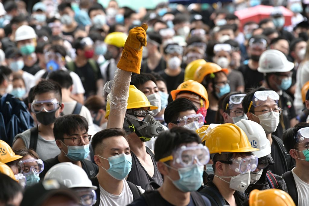 Protesters occupy the roads near the Legislative Council and government headquarters in Hong Kong on June 12, 2019.