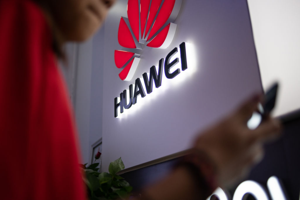 A Huawei logo is displayed at a retail store in Beijing, China on May 27, 2019.