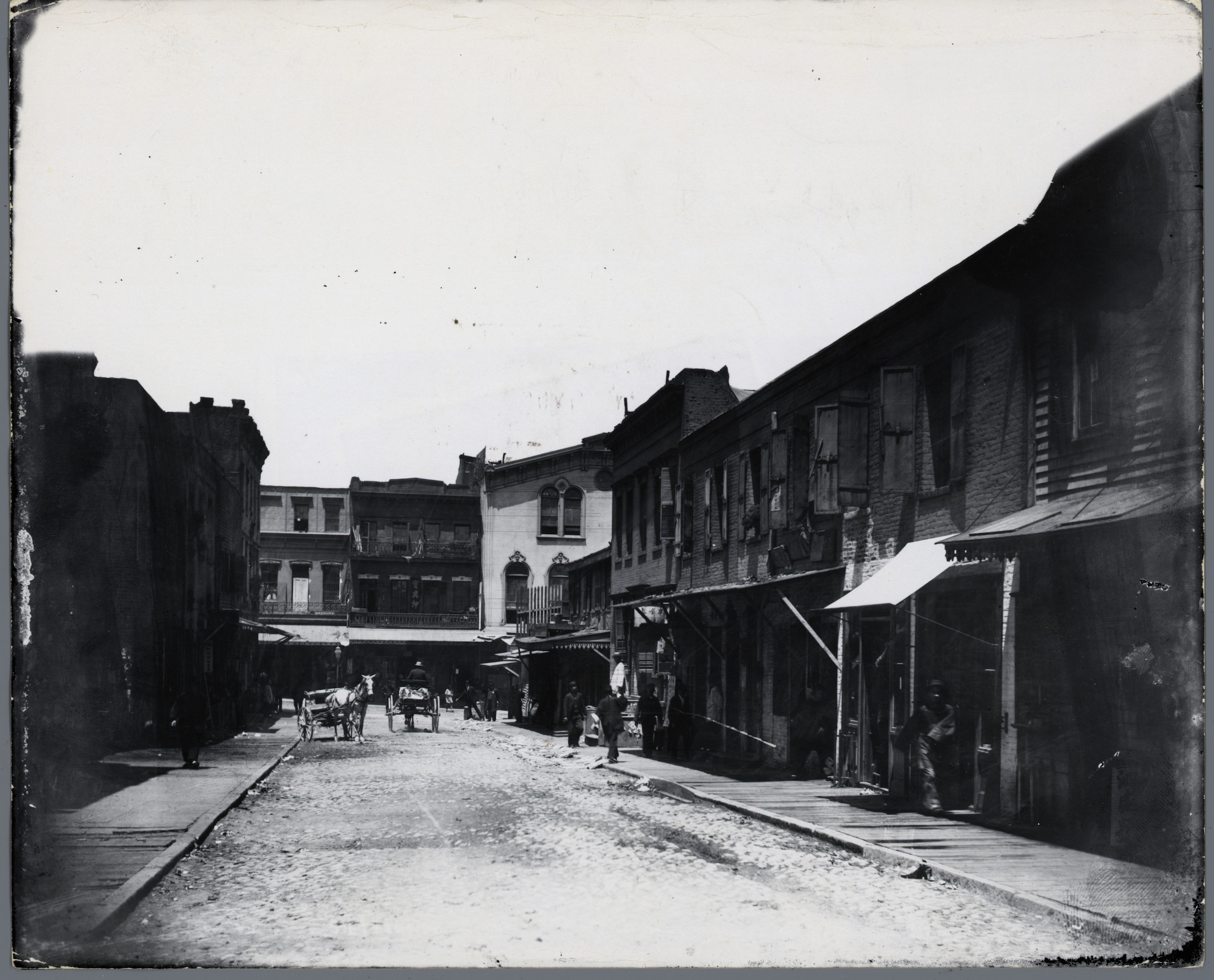 View of a Chinese immigrant community in California. Photograph circa 1900.