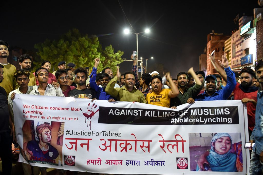 Indian Muslims hold a banner as they protest against the mob lynching of Tabrez Ansari in the Jharkhand state, in Ahmedabad on June 26, 2019.