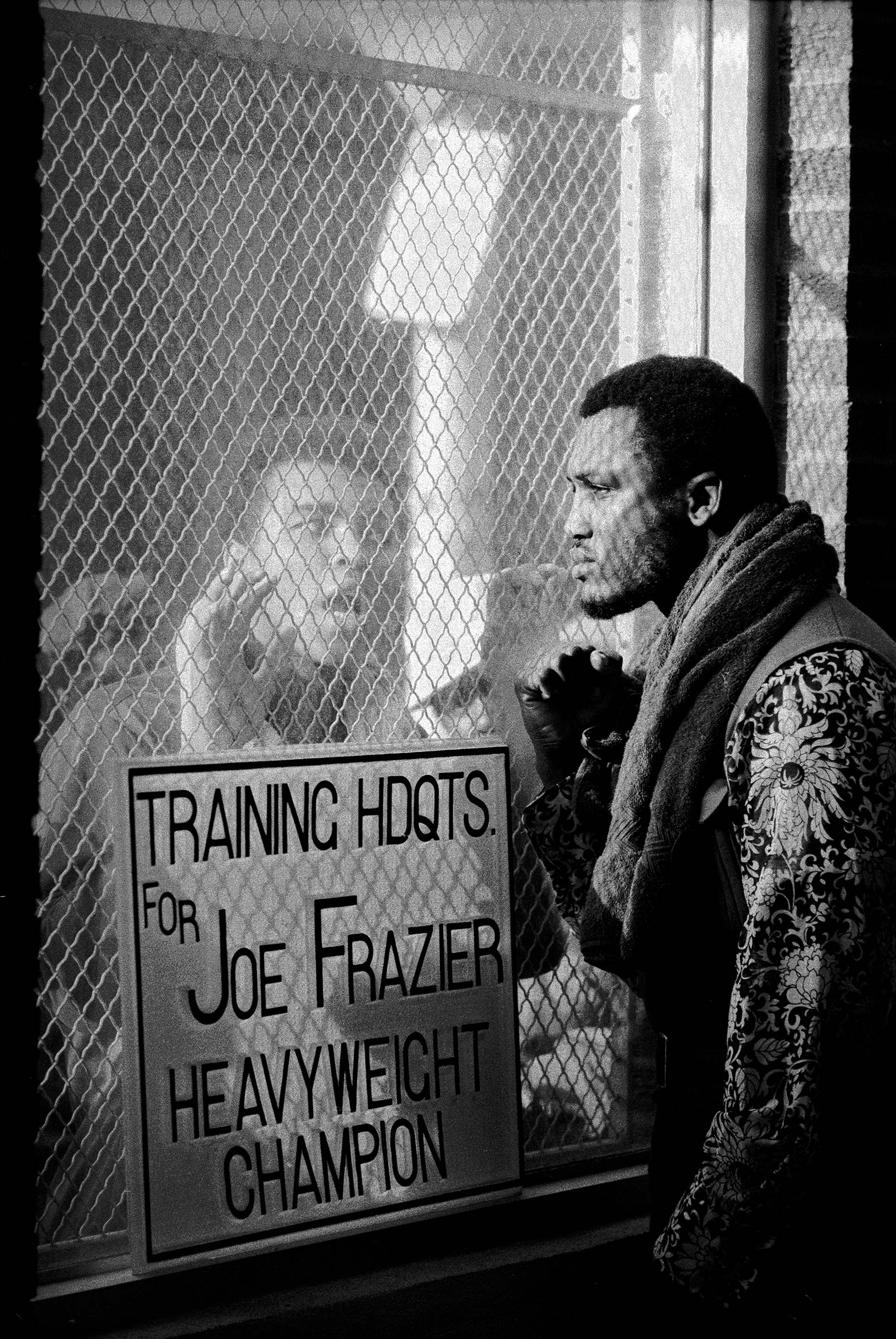 American boxer Muhammad Ali taunts rival boxer Joe Frazier at Frazier's training headquarters in Philadelphia, early 1971. The two men fought for the World Heavyweight Title on March 8—Frazier won.