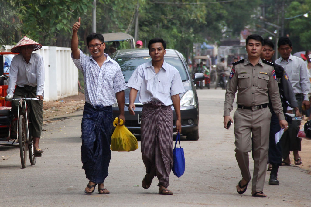 Reuters journalists Wa Lone (center L) and Kyaw Soe Oo (center R) gesture outside Insein prison after being freed in a presidential amnesty in Yangon on May 7, 2019.