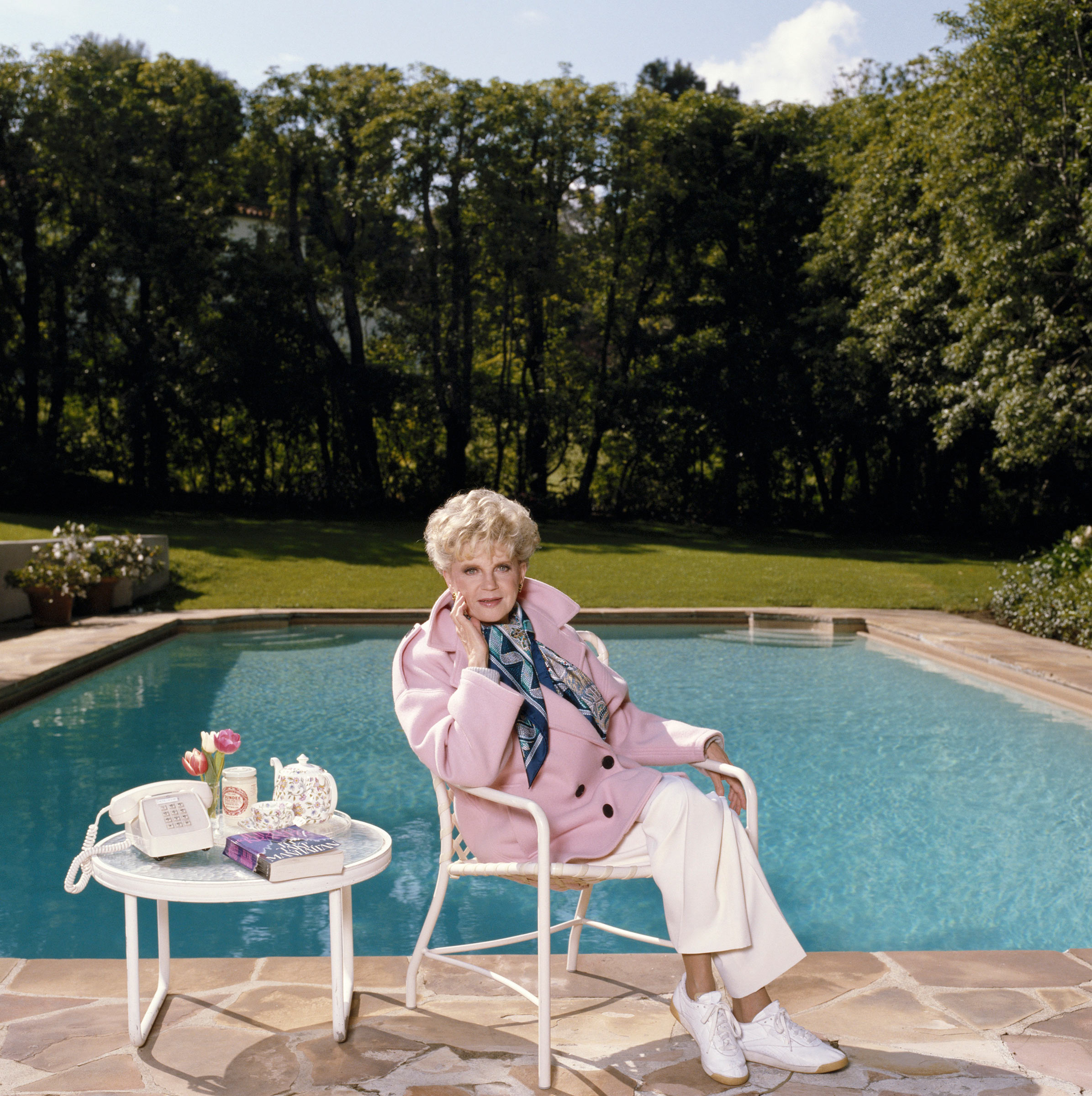 Krantz, seen by her swimming pool in 1986, got her start in                  journalism before the novel Scruples shifted her career.