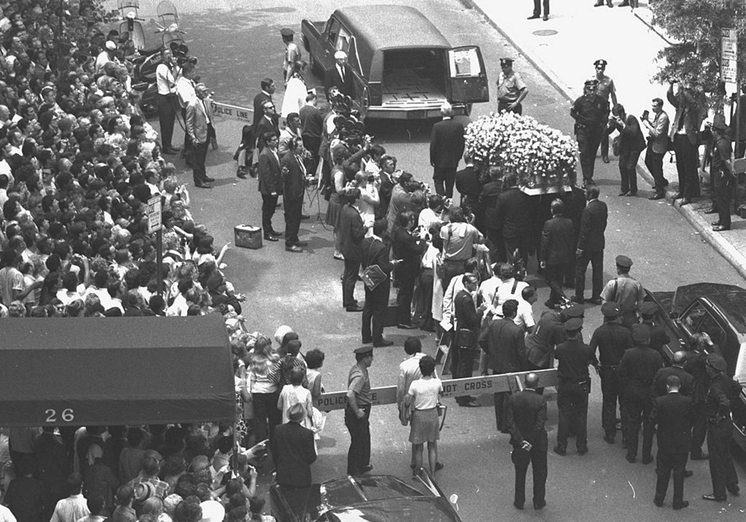 Yellow roses cover Judy Garland's coffin as it is taken to hearse at Campbell Funeral Home on June 27, 1969.