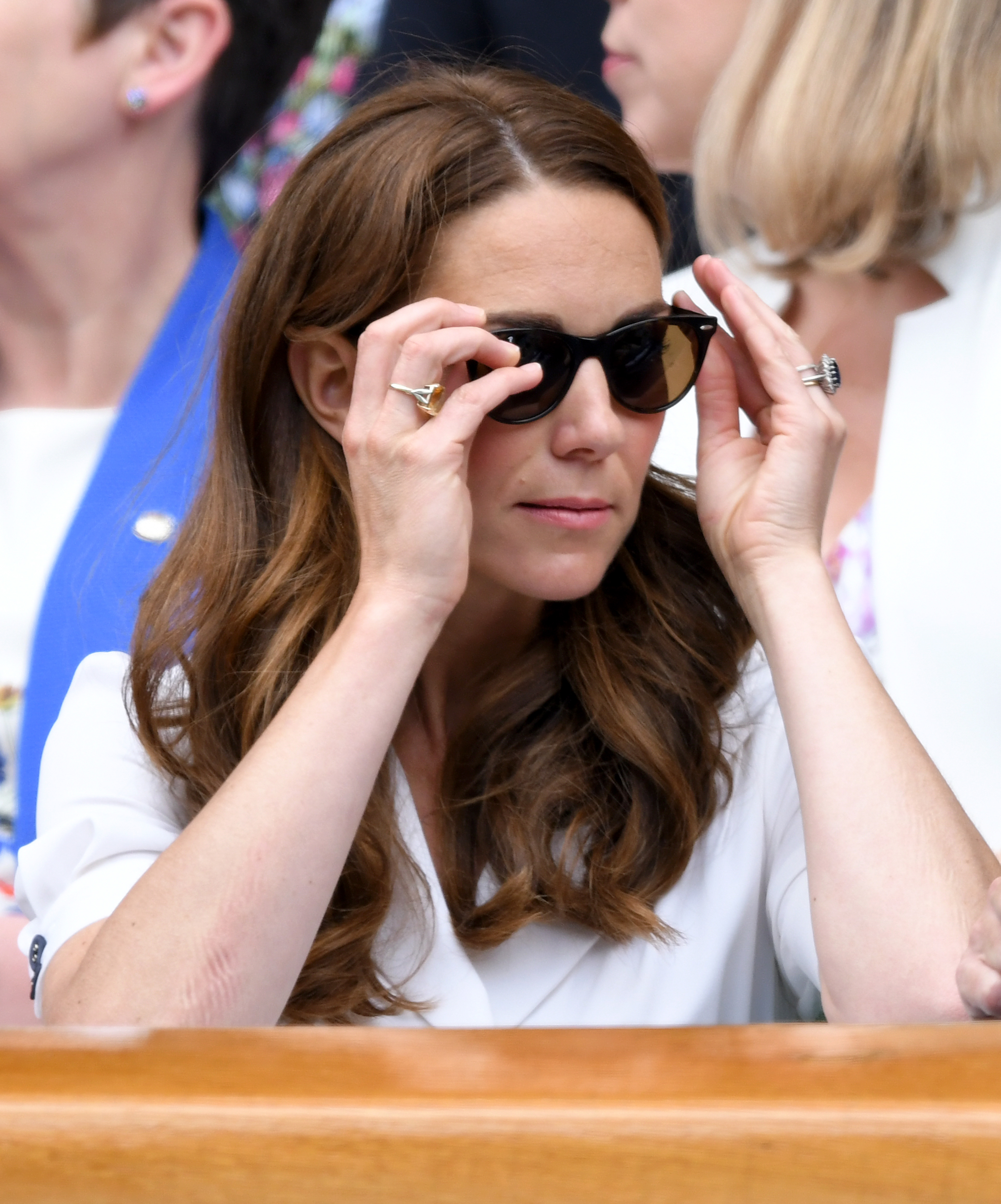 LONDON, ENGLAND - JULY 02: Catherine, Duchess of Cambridge adjusts her sunglasses as she attends day 2 of the Wimbledon Tennis Championships at the All England Lawn Tennis and Croquet Club on July 02, 2019 in London, England. (Photo by Karwai Tang/Getty Images)