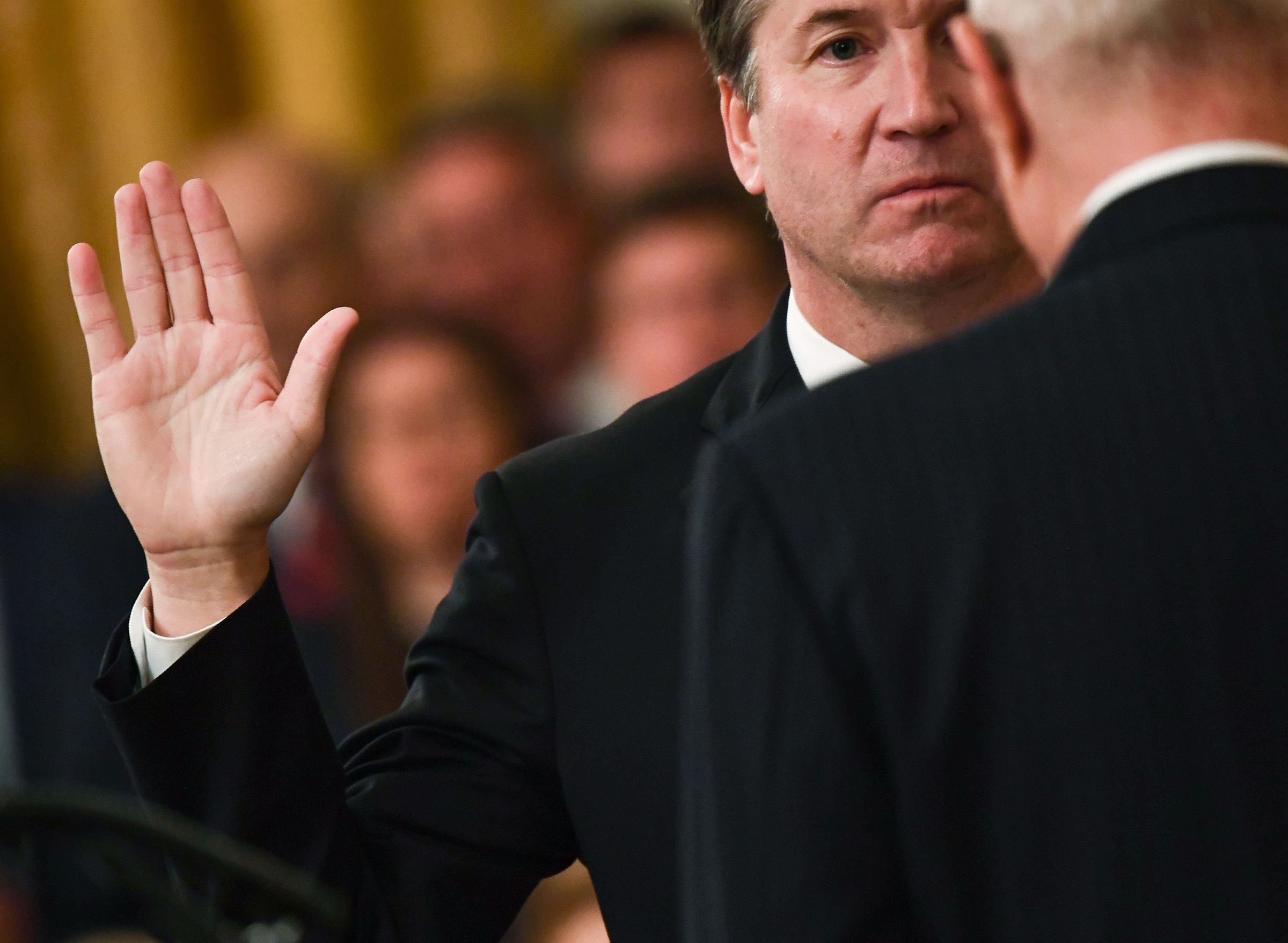 Brett Kavanaugh (L) is sworn-in as Associate Justice of the US Supreme Court by retired Associate Justice Anthony Kennedy at the White House in Washington, DC October 8, 2018.