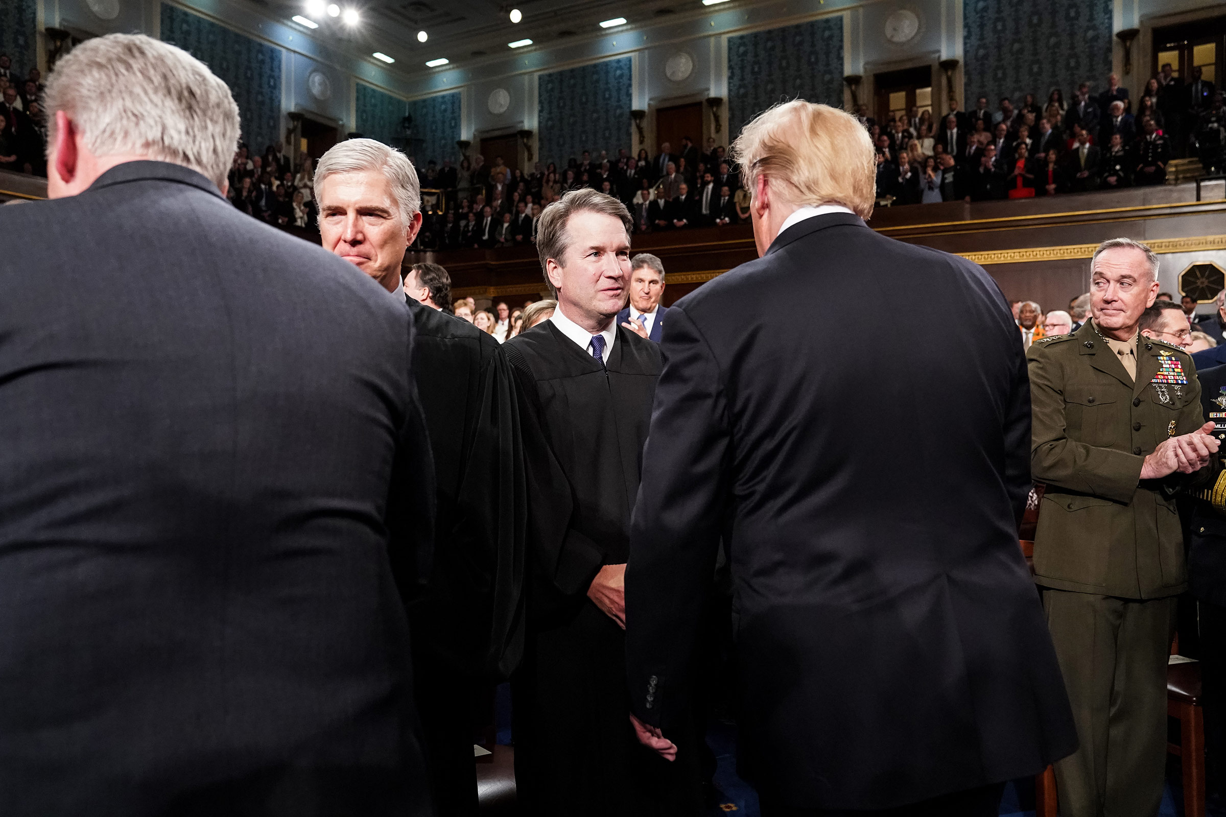 Supreme Court Justice Brett Kavanaugh shook hands with President Donald Trump before the State of the Union address at the Capitol in Washington, DC on February 5, 2019.