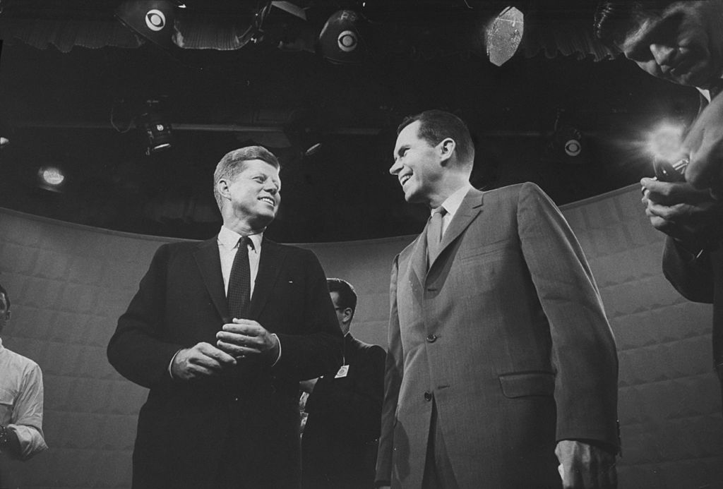 Presidential candidates John F. Kennedy and Richard M. Nixon exchanging smile prior to beginning their 1st TV debate.