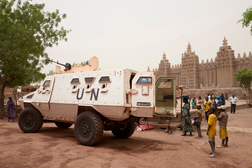 An armoured vehicle of the United Nations Multidimensional Integrated Stabilisation Mission in Mali (MINUSMA) patrols during the annual rendering of the Great Mosque of Djenne in central Mali, on April 28, 2019.