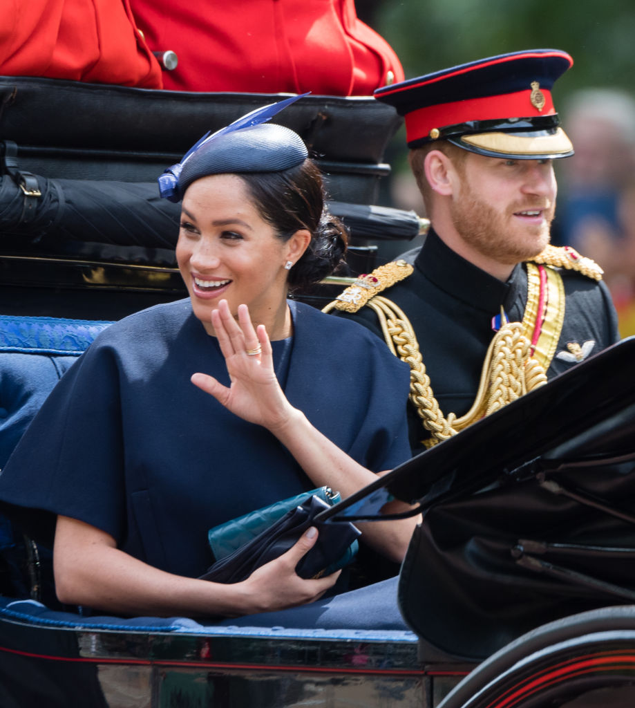 Prince Harry, Duke of Sussex and Meghan, Duchess of Sussex ride by carriage down the Mall during Trooping The Colour, the Queen's annual birthday parade, on June 8, 2019 in London, England.