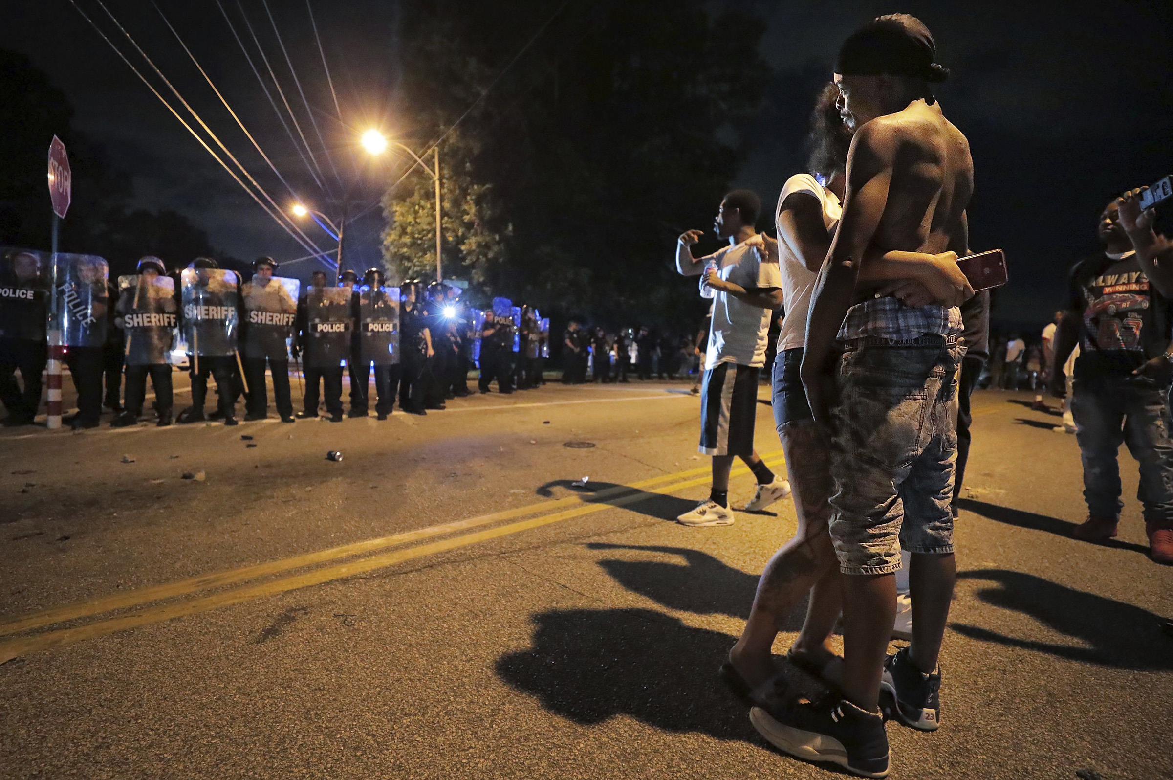 A man identified as Sonny Webber, right, father of Brandon Webber who was reportedly shot by U.S. Marshals, joins a standoff as protesters take to the streets in anger against the shooting, on June 12, 2019, in Memphis, Tennessee.