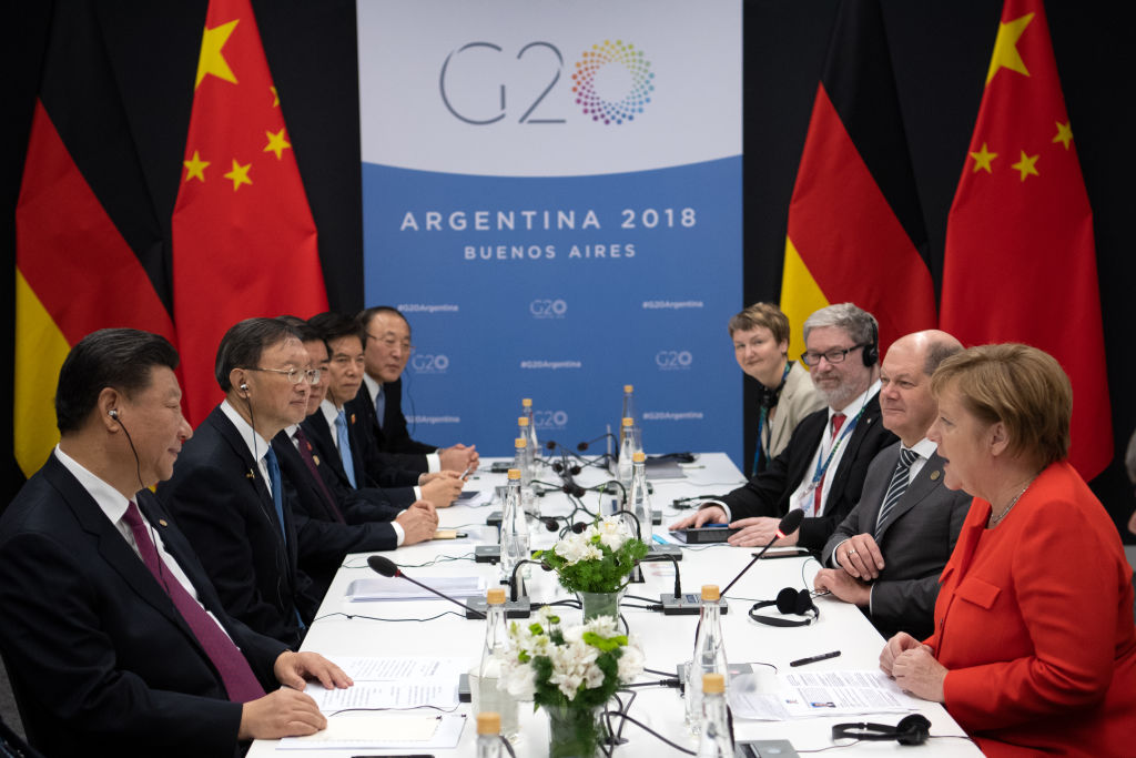 German Chancellor Angela Merkel (r, CDU) and Xi Jinping (l), President of China, meet at the G20 Summit Conference Centre for talks in Buenos Aires in 2018.