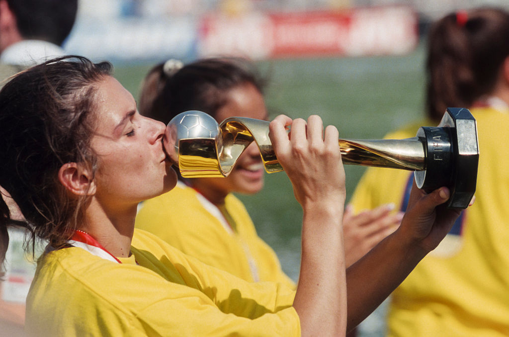 Mia Hamm, #9 of the USA, kisses the World Cup Trophy after the 1999 FIFA Women's World Cup final played against China on July 10, 1999 at the Rose Bowl in Pasadena, California.