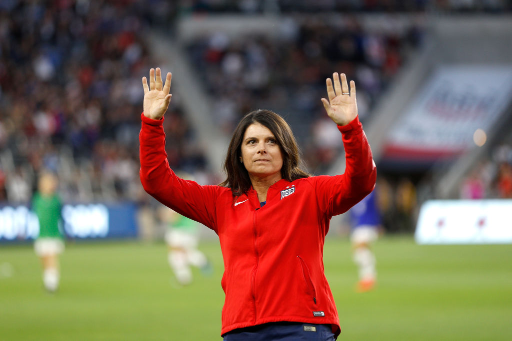 Mia Hamm of the 1999 United States Women's National Team waves to fans during halftime at Banc of California Stadium on April 07, 2019 in Los Angeles, California.