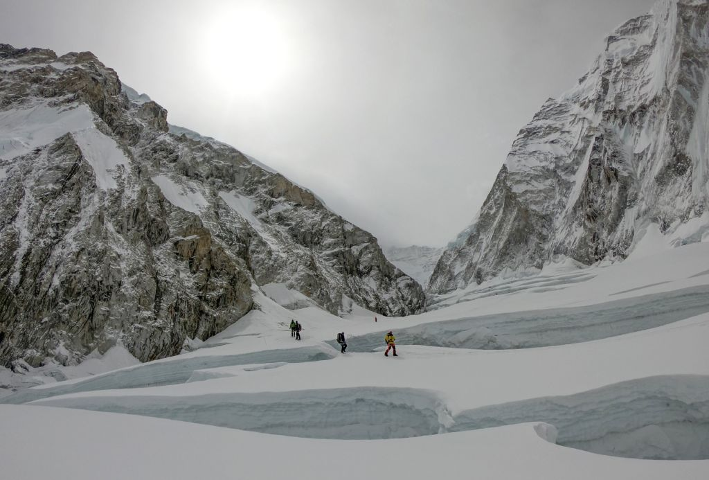 In this photo taken on April 29, 2018, mountaineers walk near camp two of Mount Everest, as they prepare to ascend on the south face from Nepal.