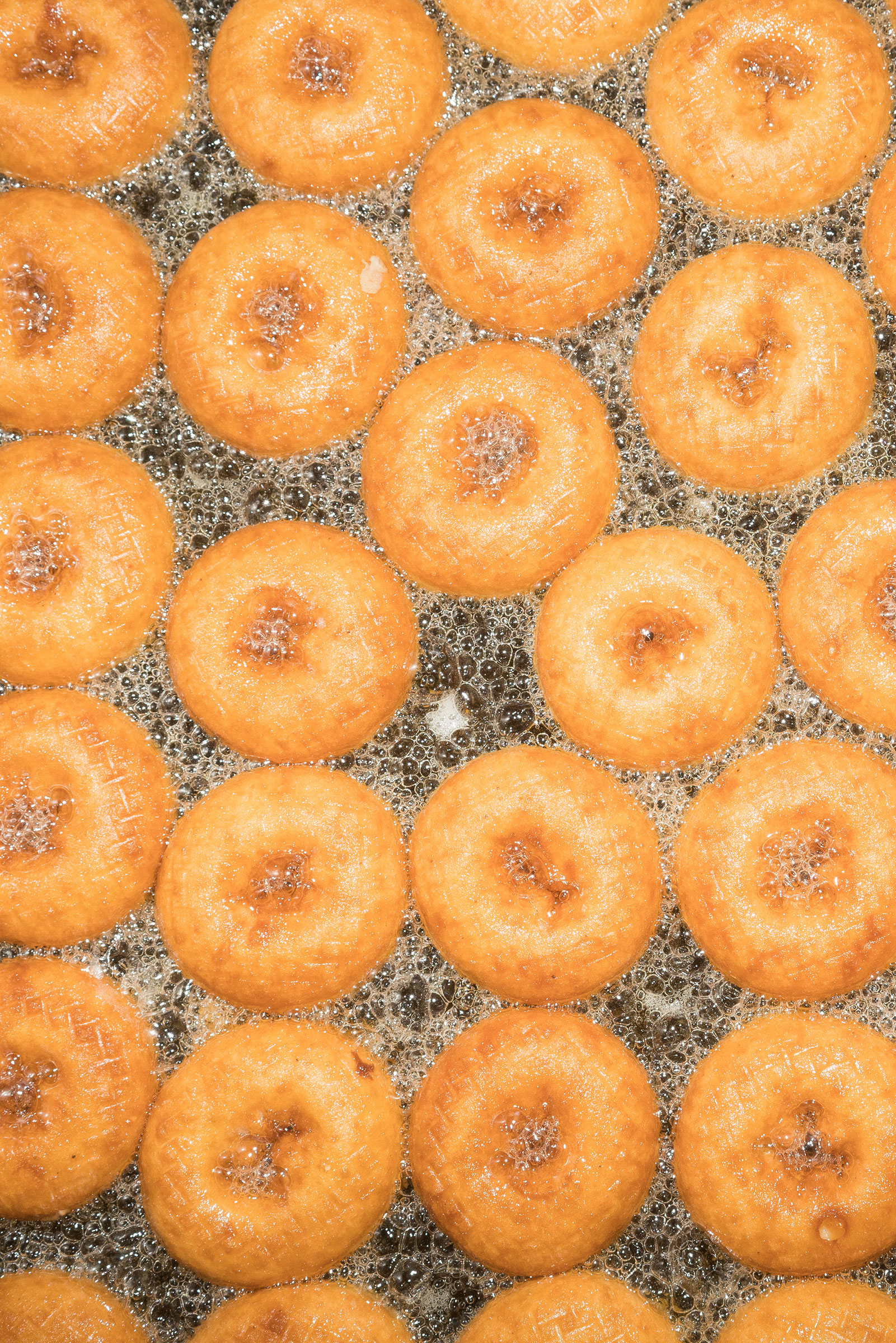Donuts frying at The Donut Man in Glendora, CA