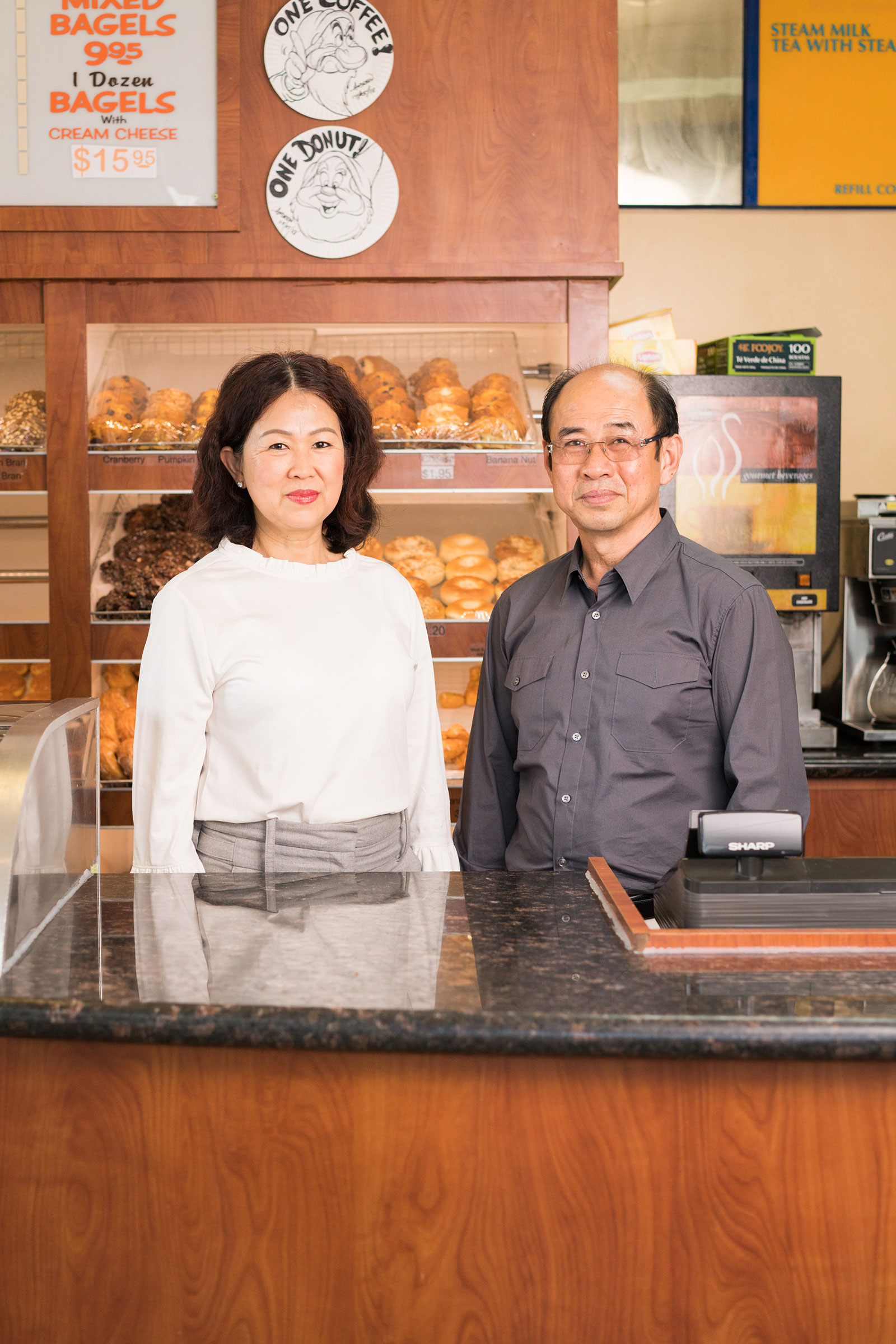 Jenny and Bruce Bu, of Dad's Donuts & Bakery, in Burbank, Calif. The couple has owned their shop for decades after fleeing Cambodia during the era of the Khmer Rouge.
