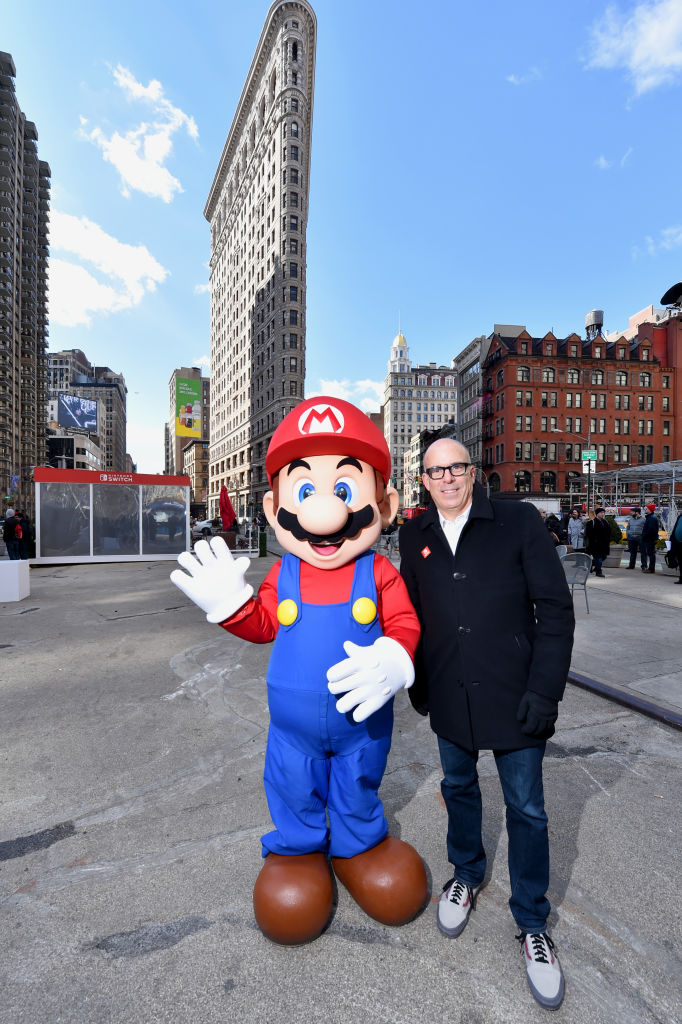 In this photo provided by Nintendo of America, Doug Bowser, Senior Vice President Sales and Marketing, poses with Mario at the Nintendo Switch in Unexpected Places activation at Madison Square Park in New York.