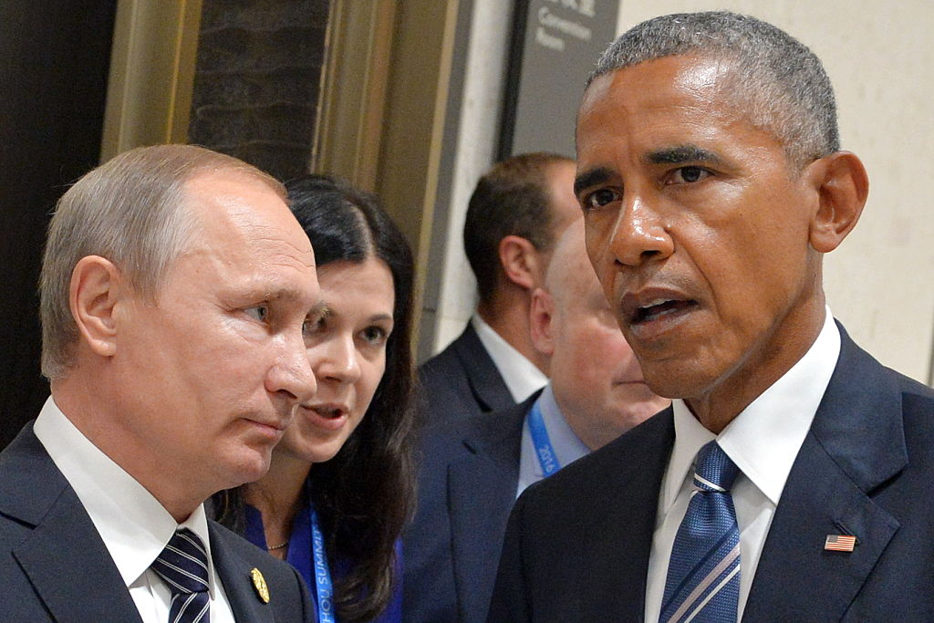 Russia's President Vladimir Putin (L) and US President Barack Obama meet on the sidelines of the G20 summit.
