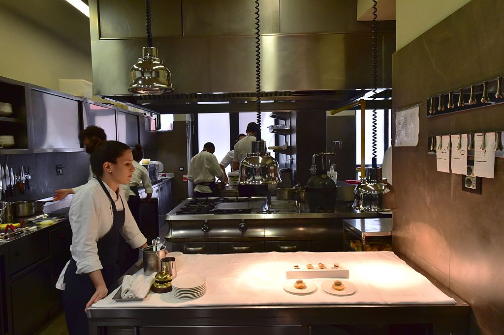 A picture taken on July 7, 2016 shows employees working in the kitchen of the  Osteria Francescana  restaurant in Modena.