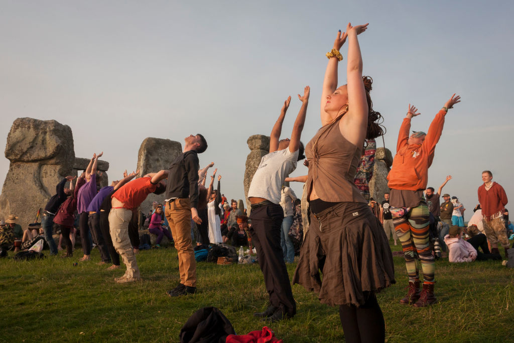 Spiritual revelers celebrate the summer solstice at the ancient stones of Stonehenge, on June 21, 2017, in Wiltshire, England.