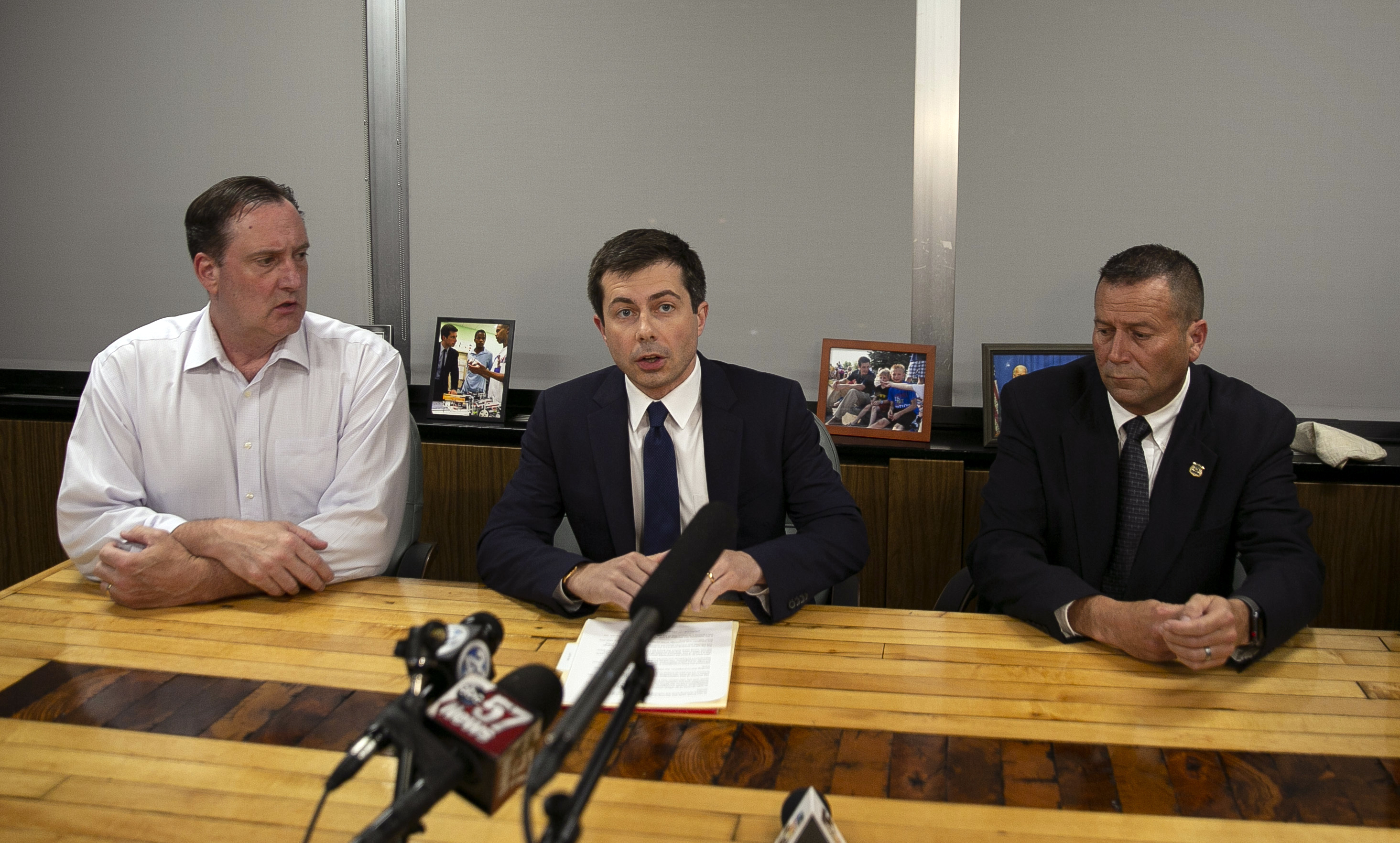 South Bend Mayor Pete Buttigieg, center, speaks during a news conference, Sunday, June 16, 2019, in South Bend, Ind., as South Bend Common Council President Tim Scott, left, and South Bend Police Chief Scott Ruszkowski, listen. Democratic presidential candidate Buttigieg changed his campaign schedule to return to South Bend for the late night news conference, after authorities say a man died after a shooting involving a police officer.