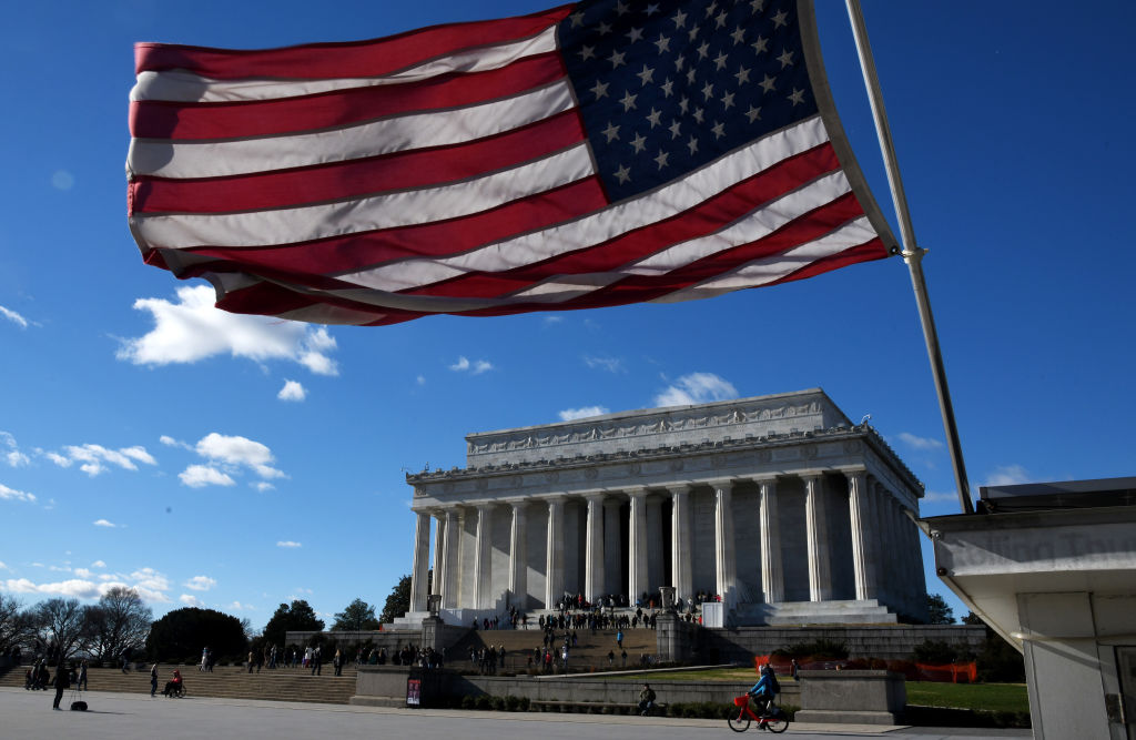 An American flag flies near the Lincoln Memorial on December 22, 2018 in Washington, DC. The government partially shutdown at midnight after congress failed to pass a spending bill.