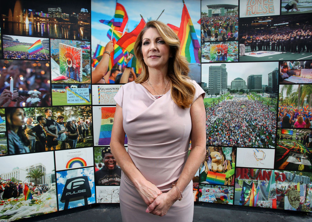 Barbara Poma, CEO of the onePULSE Foundation, in front of the Pulse Interim Memorial located at the Pulse nightclub site south of downtown Orlando, Fla., on June 6, 2019.