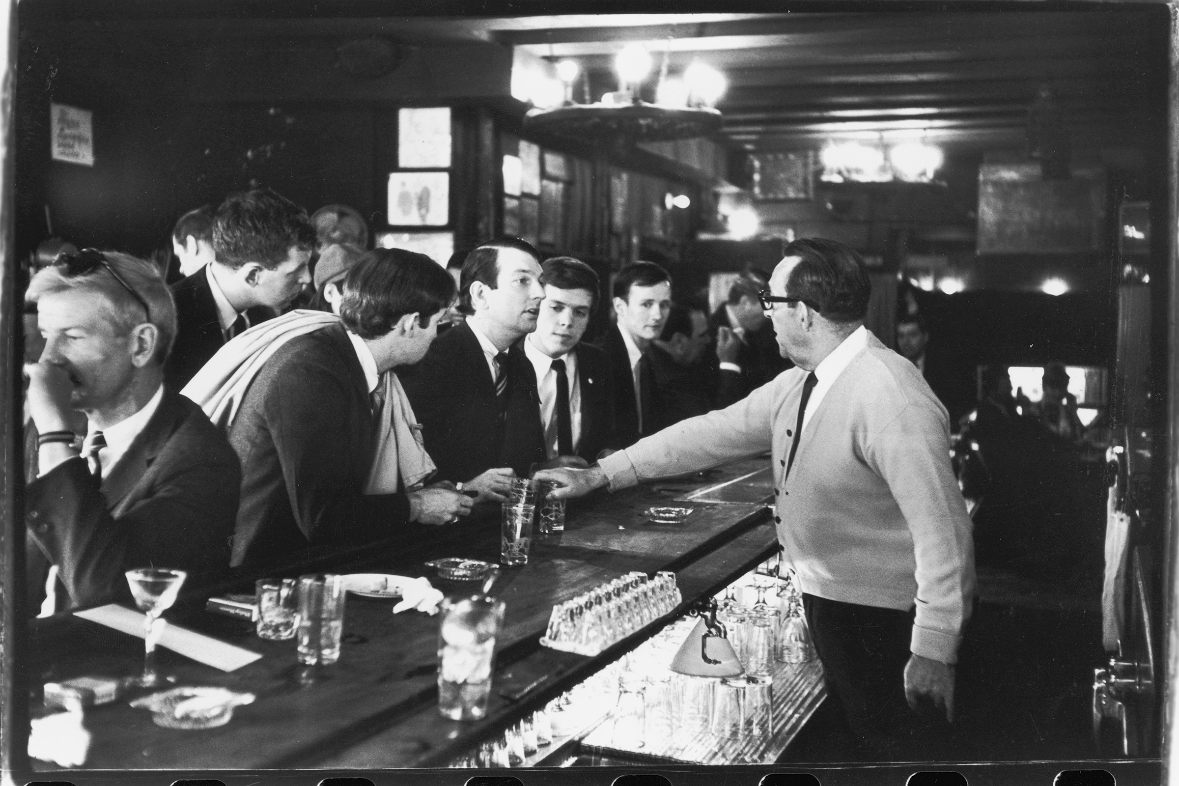 After pouring their drinks, a bartender in Julius's Bar refuses to serve (from left to right) John Timmins, Dick Leitsch, Craig Rodwell, and Randy Wicker, members of the Mattachine Society, who were protesting New York liquor laws that prevented serving gay customers, in New York, on April 21, 1966.