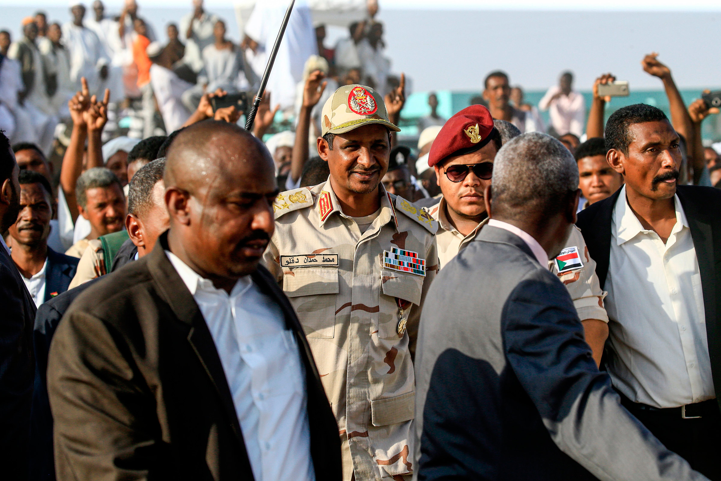 Mohamed Hamdan Dagalo, center, the deputy head of Sudan's ruling Transitional Military Council and commander of the Rapid Support Forces paramilitaries, walks in the village of Qarri, on June 15.