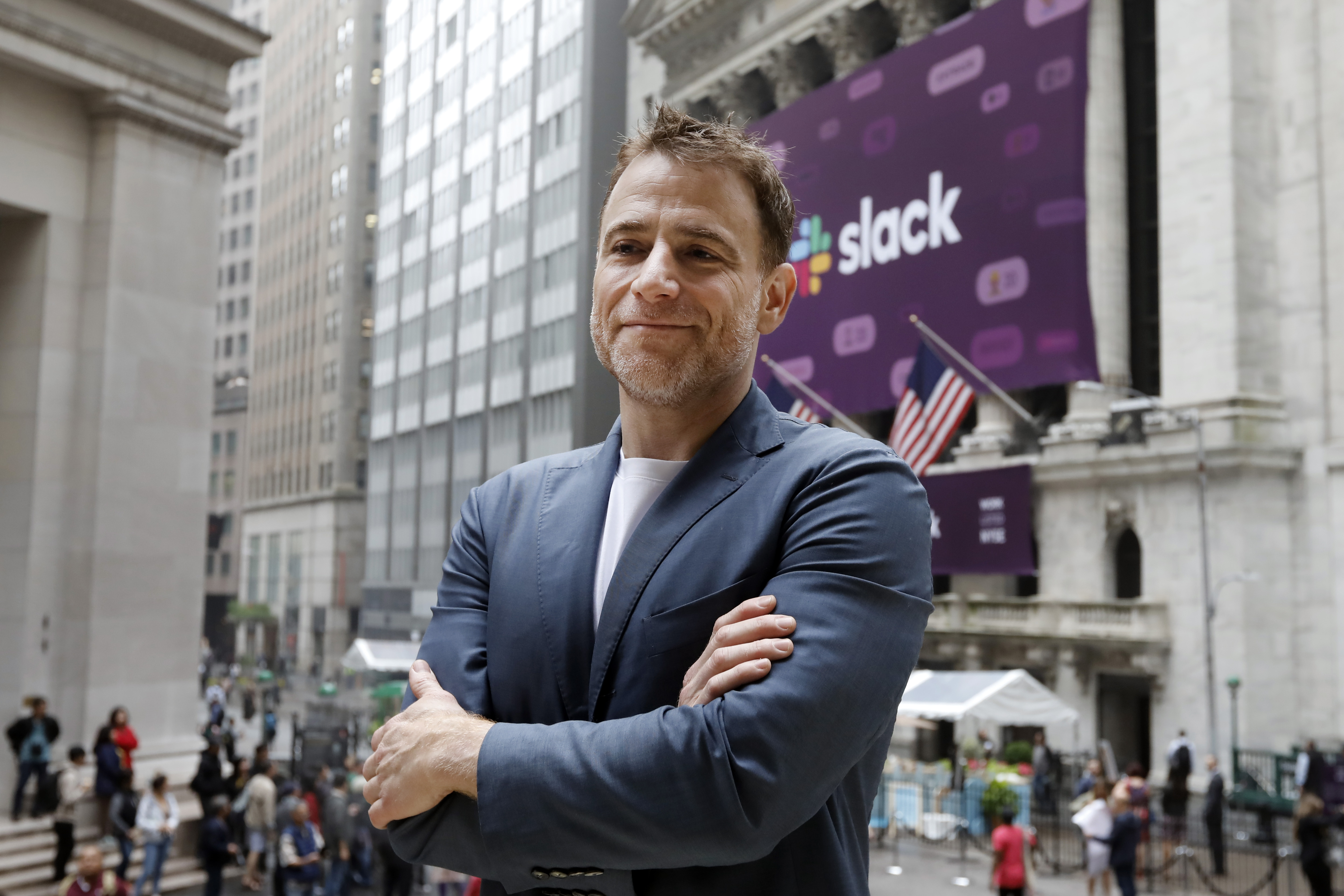 Slack CEO Stewart Butterfield poses for photos outside the New York Stock Exchange before his company's IPO, Thursday, June 20, 2019.