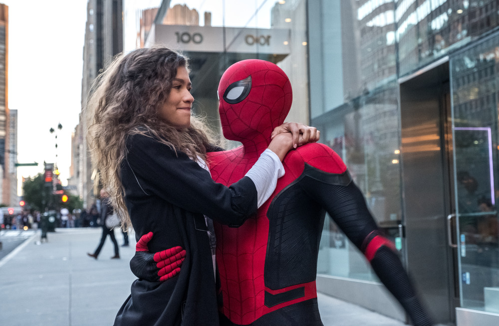 Michelle (Zendaya) catches a ride from Spider-Man (Tom Holland) in Spider-Man: Far From Home