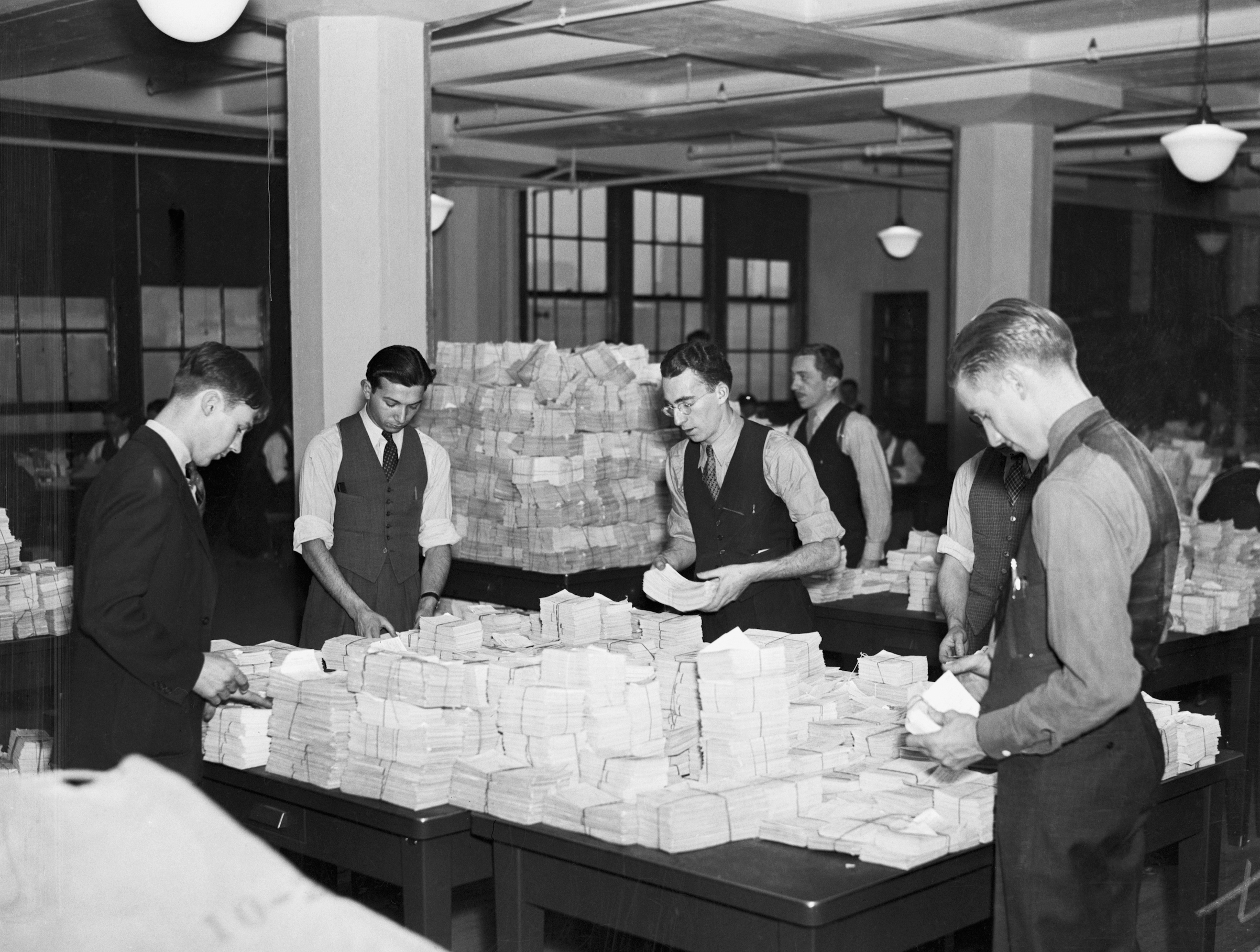 Employees at work establishing individual social security accounts for millions of workers at the wage records office in 1936