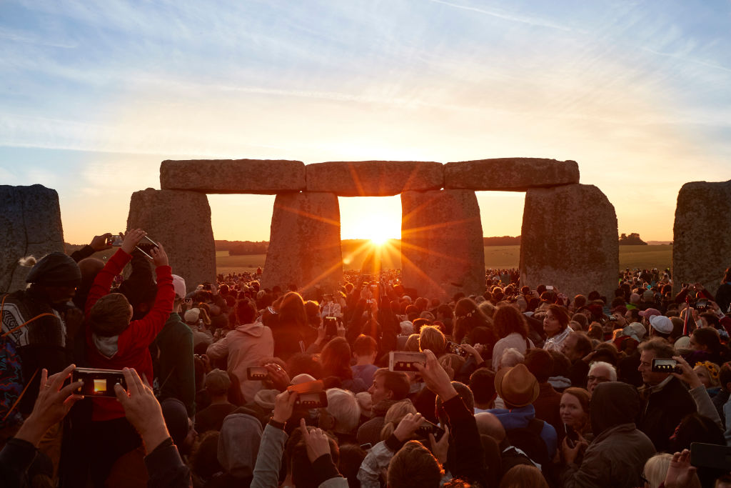 Thousands celebrate the summer solstice and the dawn of the longest day of the year at Stonehenge on June 21, 2018 in Wiltshire, England.
