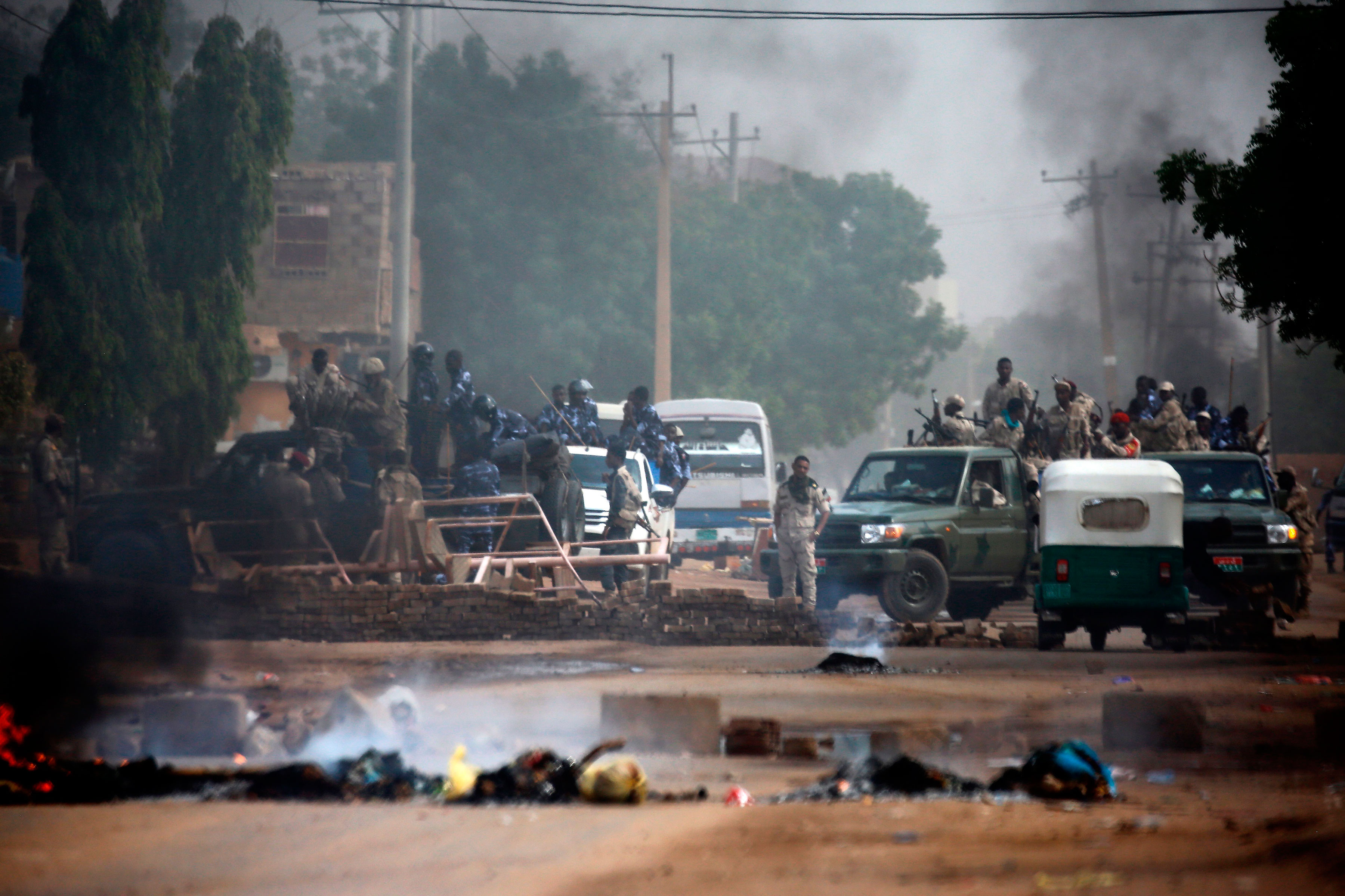 Sudanese forces are deployed around Khartoum's army headquarters as they try to disperse Khartoum's sit-in on June 3, 2019.