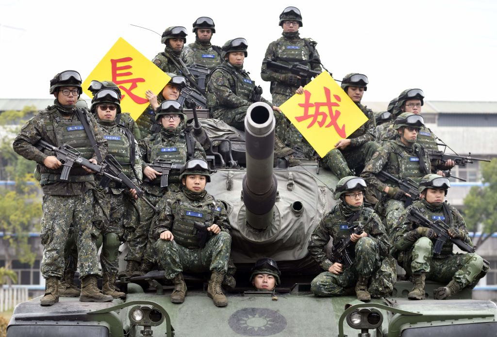 Taiwanese soldiers pose for photos on an US-made M60-A3 tank after an exercise in Taichung, central Taiwan on Jan. 17, 2019.