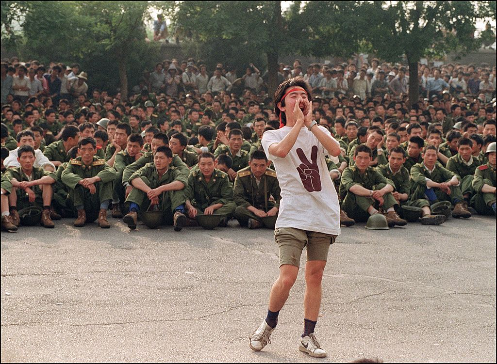A dissident student asks soldiers to go back home as crowds flooded into the central Beijing June 3, 1989.