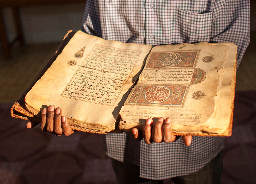 A librarian in Juma Al Majid Centre for the manuscripts conservation and restoration of Timbuktu shows one of the old manuscripts on January 19, 2010 in Timbuktu, Mali.