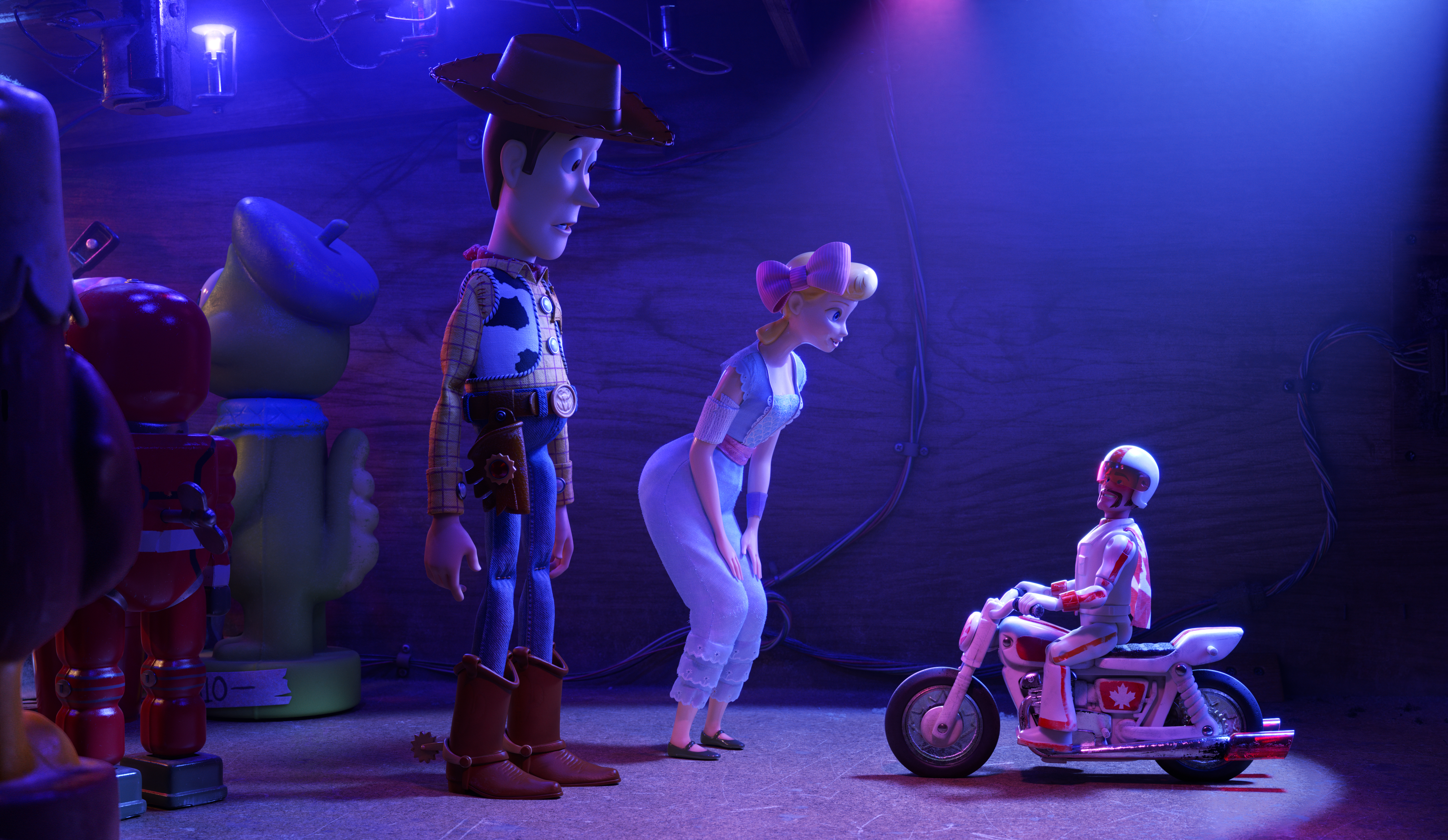 Tom Hanks as the voice of Woody, Annie Potts as the voice of Bo Peep, and Keanu Reeves as the voice of Duke Caboom in Toy Story 4