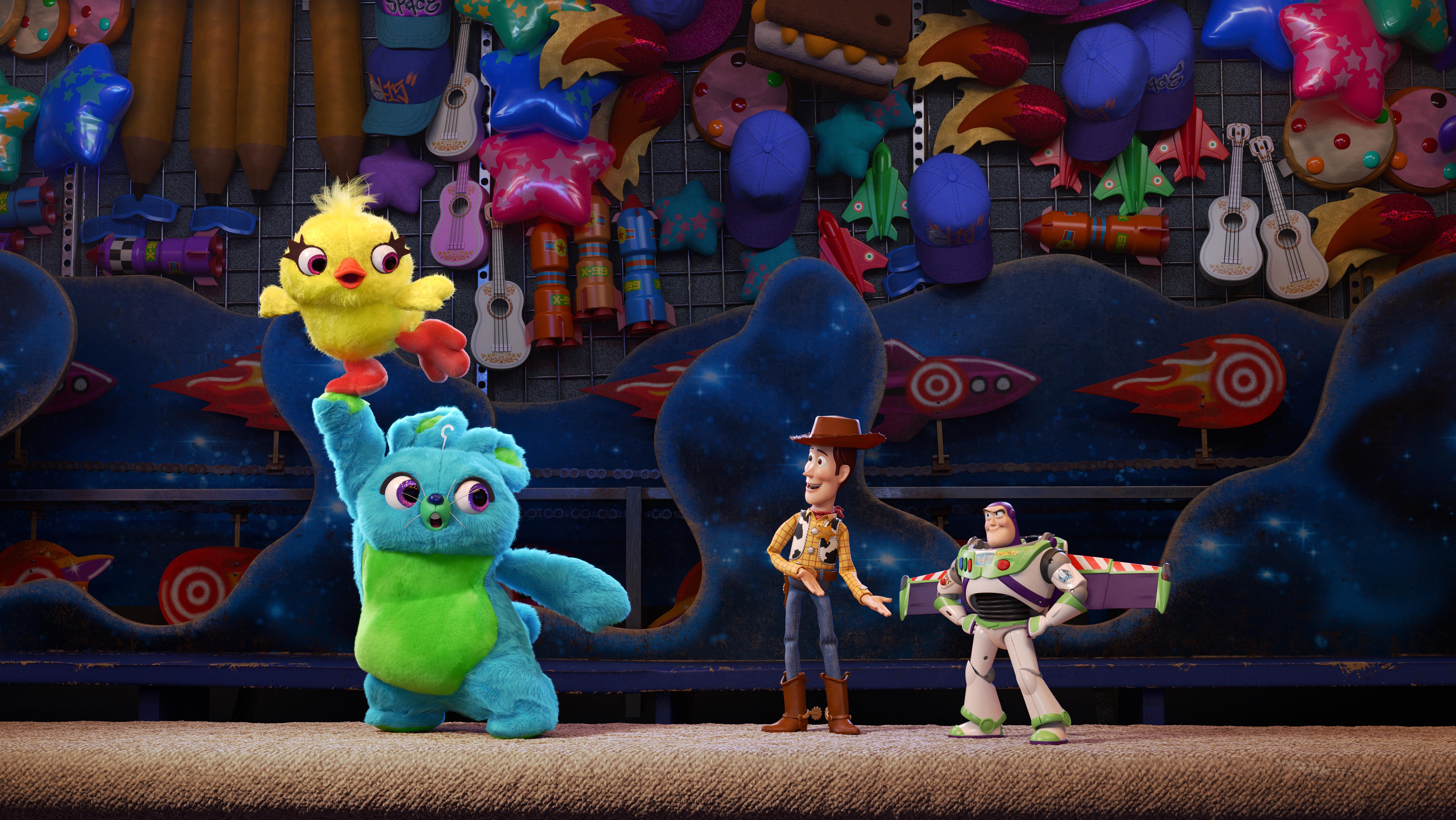 Keegan-Michael Key as Ducky, Jordan Peele as Bunny, Tom Hanks as Woody and Tim Allen as Buzz in Toy Story 4