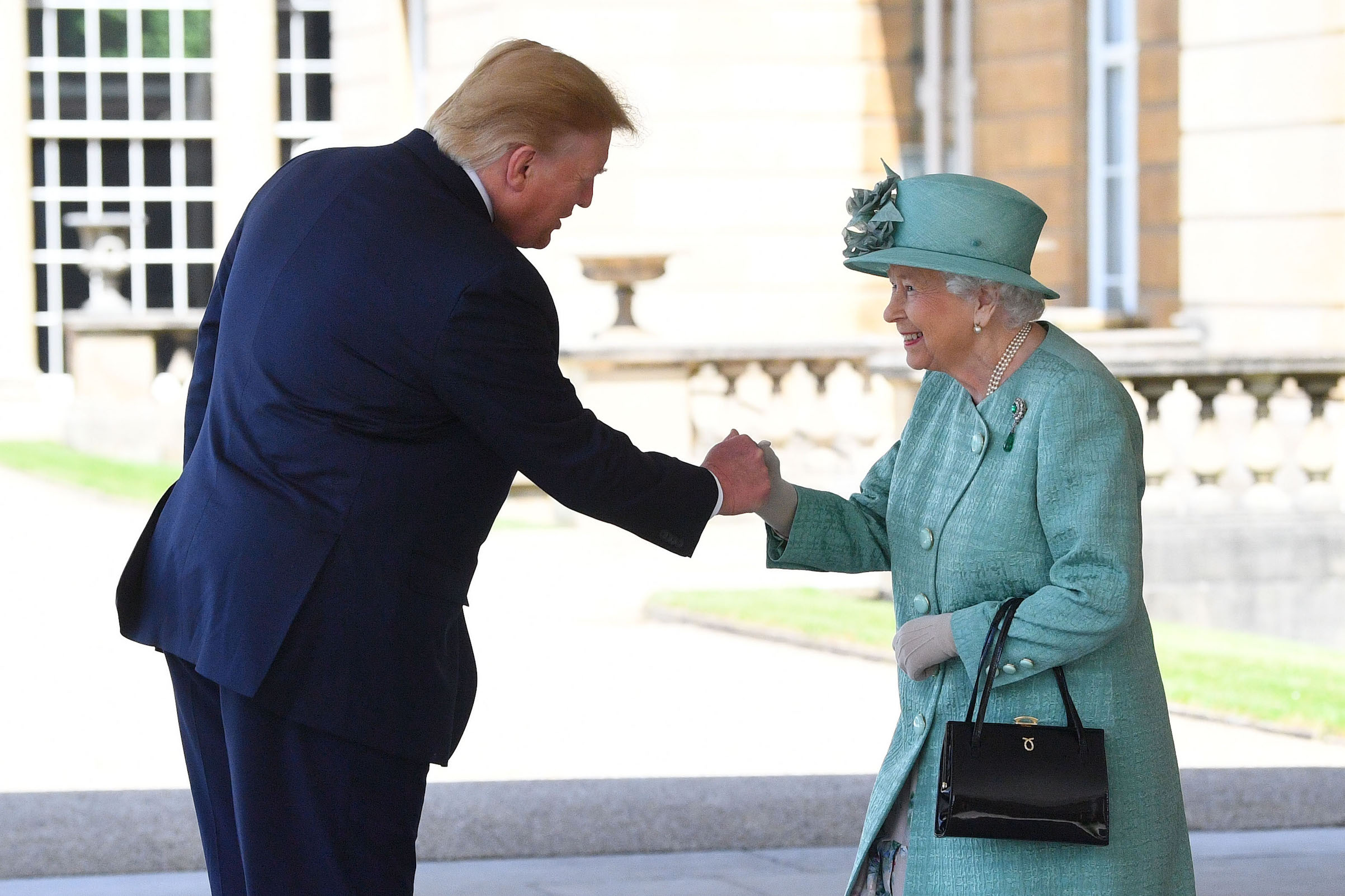 Queen Elizabeth II greets US President Donald Trump as he arrives for the Ceremonial Welcome at Buckingham Palace, London, on day one of his three day state visit to the U.K. on June 3, 2019.