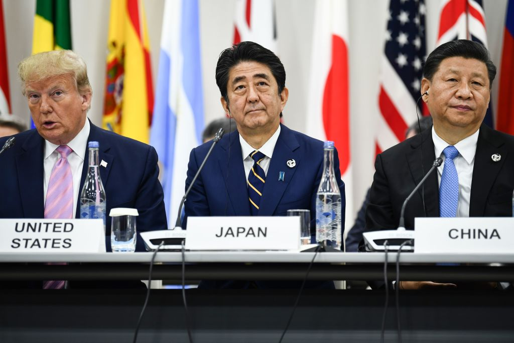 President Donald Trump, Japan's Prime Minister Shinzo Abe and China's President Xi Jinping attend a meeting at the G20 Summit in Osaka on June 28, 2019.