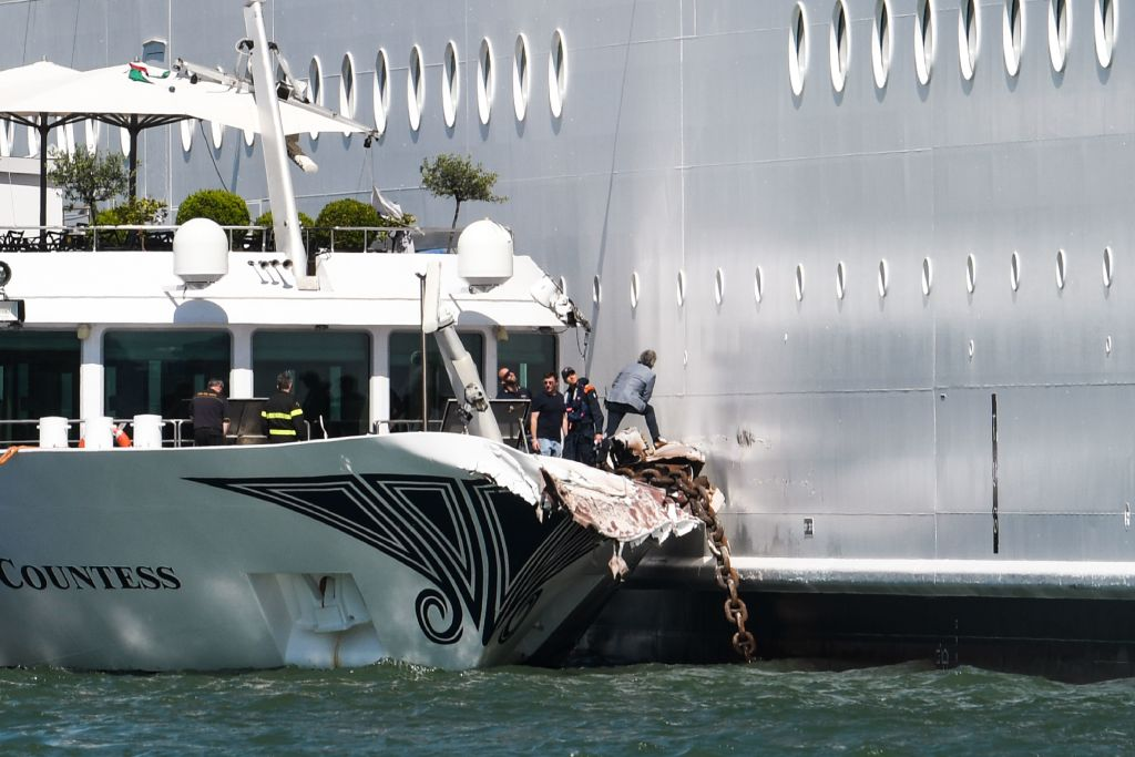 A tourist boat is pictured after it was hit early on June 2, 2019 by the MSC Opera cruise ship that lost control as it was coming in to dock in Venice, Italy. (Photo by Andrea Pattaro / AFP/Getty Images)