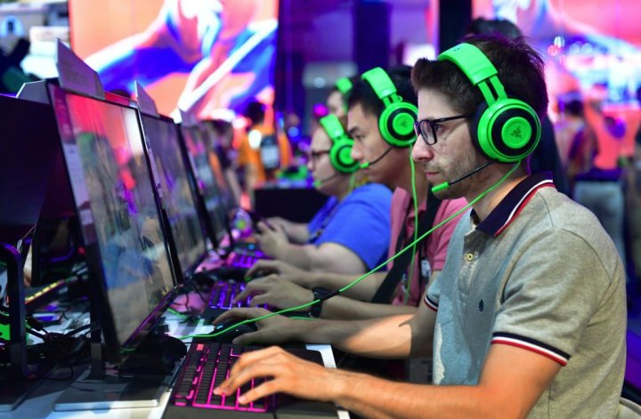 Video game workers wear headsets at E3 in Los Angeles