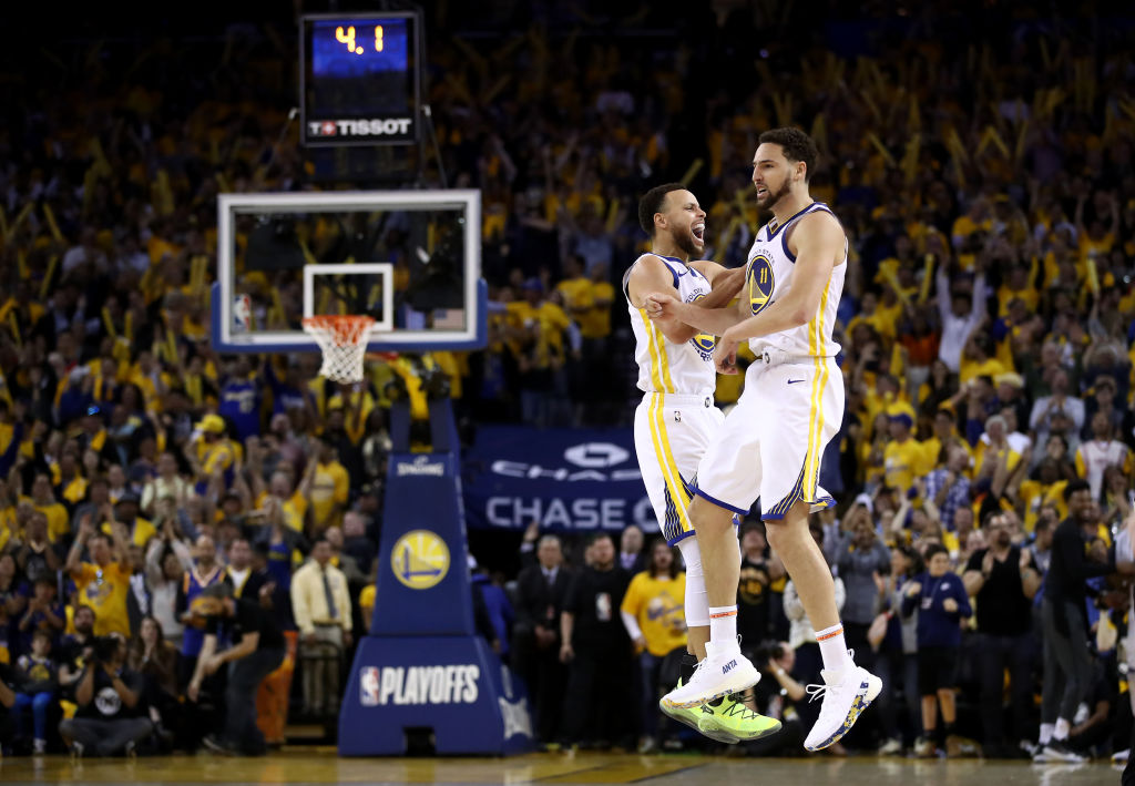 Stephen Curry #30 of the Golden State Warriors celebrates with Klay Thompson #11 after Thompson made the clinching basket with four second left of their game against the Houston Rockets in Game Five of the Western Conference Semifinals of the 2019 NBA Playoffs at ORACLE Arena on May 8, 2019 in Oakland, California.