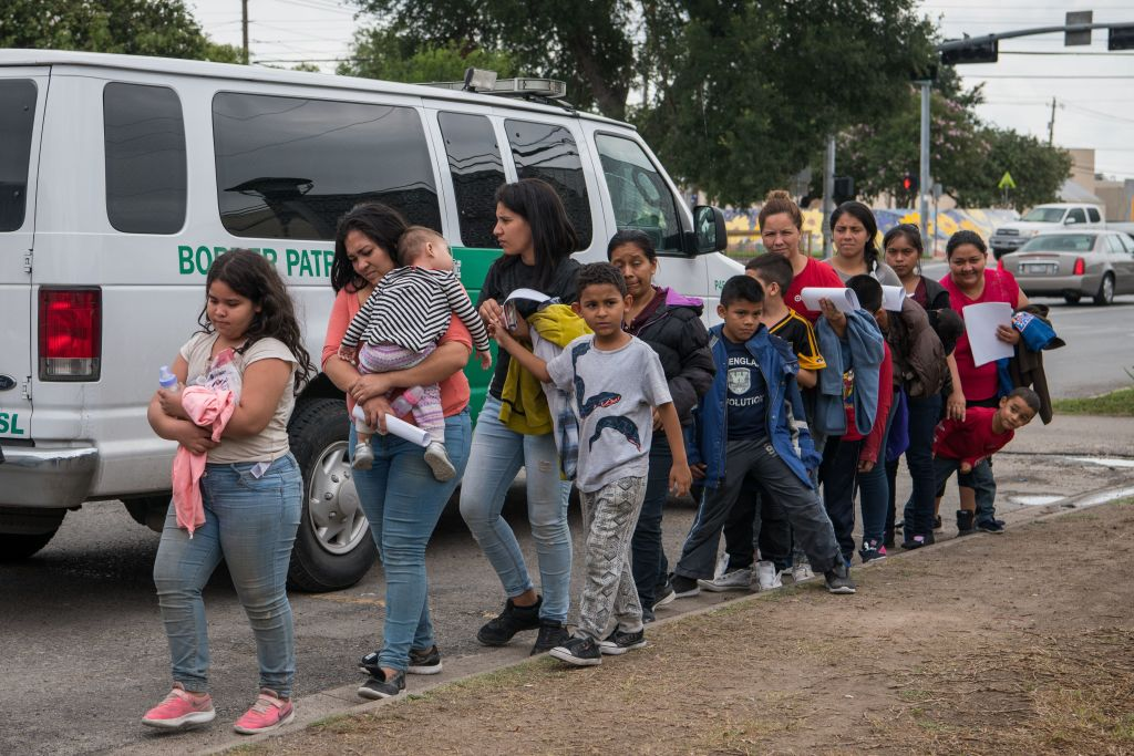Central American migrant families arrive at a Catholic Charities respite center after being released from federal detention on June 12, 2019, in McAllen, Texas.